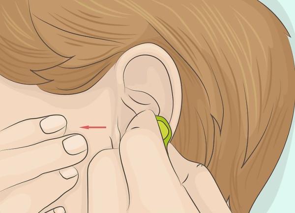 قرار دادن کامل لاستیک هندزفری در گوش